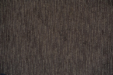 Surface of floor covering brown carpet with strips