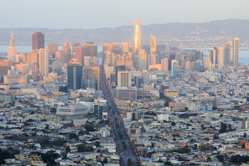 Sunset lights on San Francisco Downtown. Northeast views from Twin Peaks.