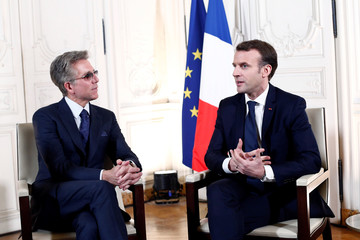 "French President Emmanuel Macron attends a meeting with Bill McDermott, CEO of SAP SE, during the ""Choose France"" summit, at the Chateau de Versailles"
