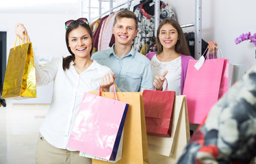 Young adults with purchases in shop