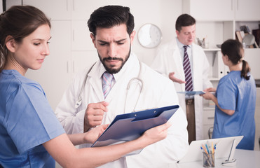 Doctor with younger female colleague