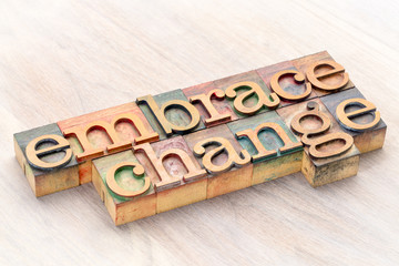 embrace change word abstract in wood type