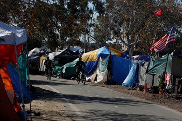 City officials have begun what they are calling a slow and methodical clean-up and removal of a large homeless encampment along the Santa Ana River Trail in Anaheim, California