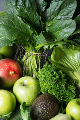 Fresh green vegetables and fruits, ingredients for dietary healthy detox smoothie or salad