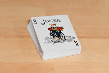 Playing cards deck with Joker card on top