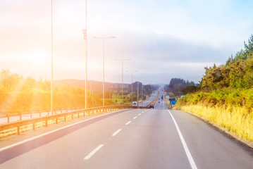 Intercity highway with shining sun Wall mural