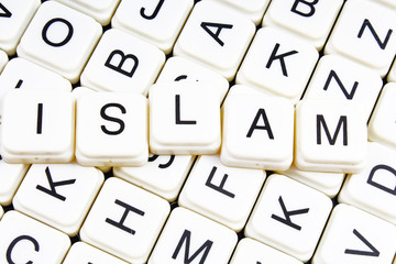 Islam text word crossword title caption label cover background. Alphabet letter toy blocks. White alphabetical letters.