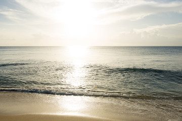 Water Waves, Beach, and Sun Setting into Ocean for Backgrounds