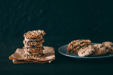 Chocolate chip cookies on dark old wooden table with place for text., freshly baked. Selective Focus with Copy space