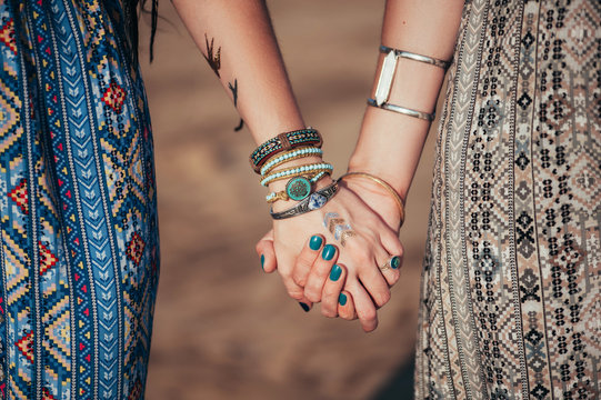 close up hands with boho accessories