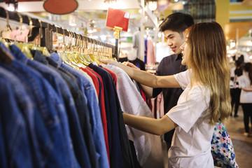 Young asian couple shopping