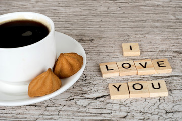 i love you letters and coffee cup on white wooden cafe table