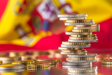 National flag of spain and euro coins - concept. Euro coins. Euro money. Euro currency