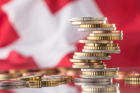 National flag of switzerland and euro coins - concept. Euro coins. Euro money. Euro currency