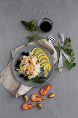 Risotto with seafood on a gray background