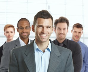 Portrait of happy businessman and team