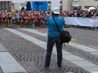Sport Photographer Shooting Marathon Runners Ready for the Race at Starting Line