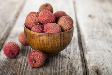 Lychee in a wooden bowl