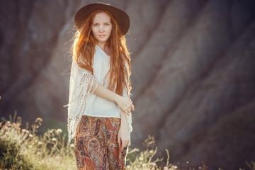 A young girl in a boho style, on the coast with her dog. The idea and concept of freedom and hippies