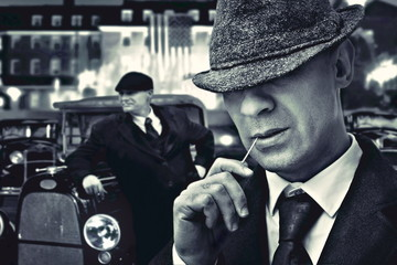 vintage bossy Italian mafia gangsters in 1930's near classic car