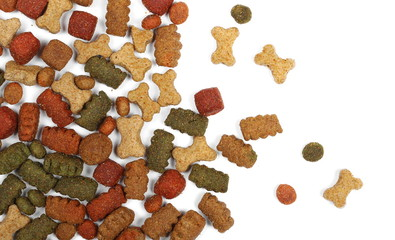 Dry colorful dog food isolated on white background, top view