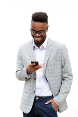 smiling young businessman looking at mobile phone