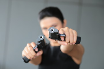 woman hand with a gun