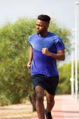 african american man running outdoors