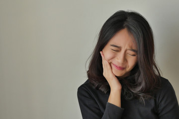 woman suffering toothache, girl with tooth decay, sensitivity, dental care treatment concept