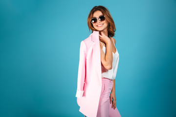Portrait of a pretty woman dressed in pink suit