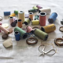 Sewing supplies on a white fabric