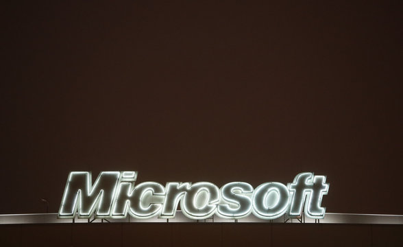 A view shows the logo of Microsoft company on the roof of an office building in Moscow