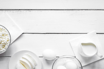 Healthy food concept with milk on white table top view mock-up