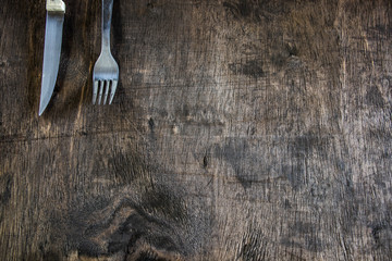 Cutlery on a rustic background. Knife and fork