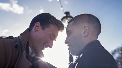 Young male couple sharing an intimate moment in the morning sunlight