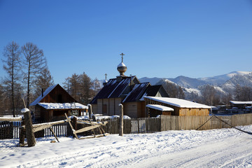 A small church in russian village Zamulta in winter in Uimon Valley, Altai mountains.