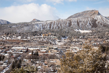 Snow on downtown Durango, Colorado with Hogsback and Perin's peak