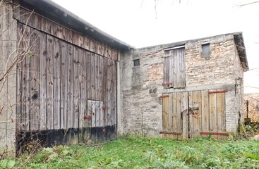 Old barn built of wood, brick and stone