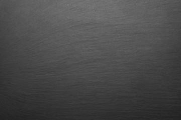 Dark stone background texture. Blank for design.
