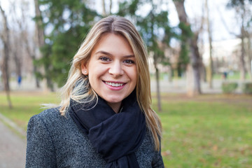 Woman smiling at the camera in the park