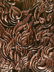 thai art carving on plank wood