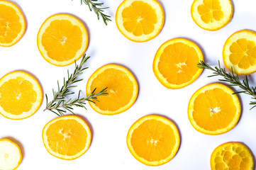 Sliced oranges with rosemary background pattern isolated