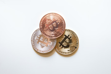 gold copper silver bitcoin isolated on white background