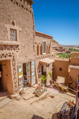 Narrow streets of Kasbah Ait Ben Haddou with traditional moroccan souvenirs, Morocco