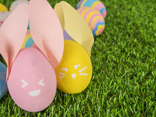 Painted Easter eggs on a grass yard, concept for Easter