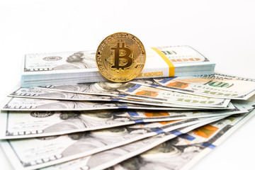 Physical version of Bitcoin and banknotes of  dollar isolated on white background