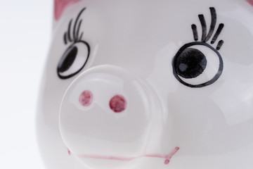 Close up of the face of a ceramic lucky pig