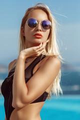 Young model girl in black bikini