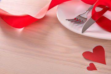 Table decorated with red ornaments for valentines day elevated view