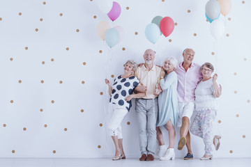 Older people with balloons